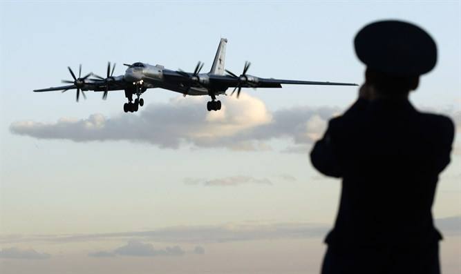 Russian officer takes picture of Tu-95 bomber