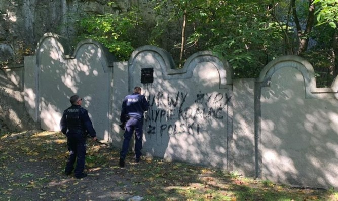 Swastika and other graffiti painted on wall of the former Krakow Ghetto